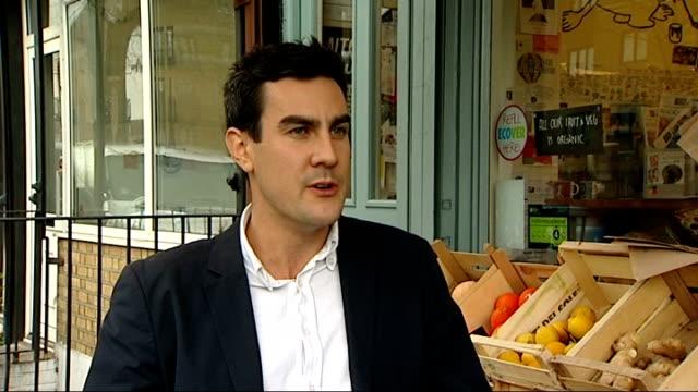 investigations continue ENGLAND London EXT Ben Williamson interview SOT / Ben Williamson set up shots outside greengrocer shop