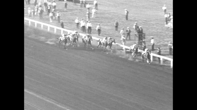 vs horse races with vo race called by clem mccarthy in one race head play comes in second / [derby footage starts at 0032] horses in backstretch they... - commentator stock videos & royalty-free footage