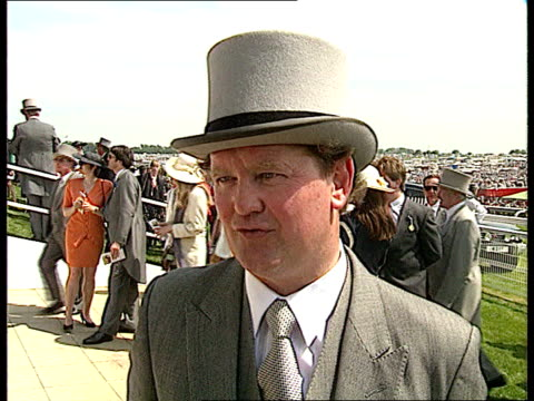 stockvideo's en b-roll-footage met derby england epsom ms side racehorse platos republic led lr in enclosure cms john jenkins intvw sot horse does not know the odds against him as he... - john mccririck