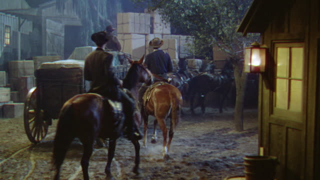 ms horse riders and loaded carriage enter in godown - kutsche stock-videos und b-roll-filmmaterial
