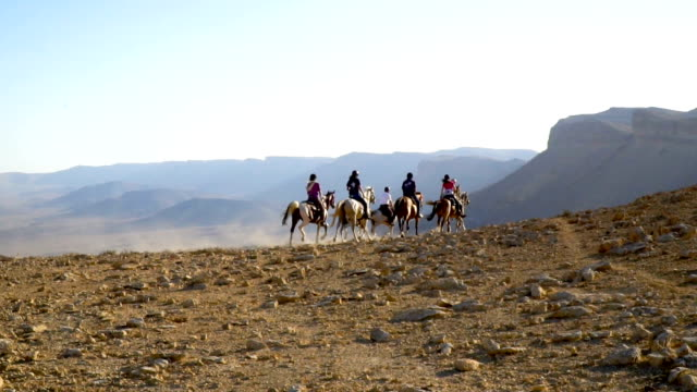 Horse riders on the edge of Makhtesh Ramon, Negev desert, Israel