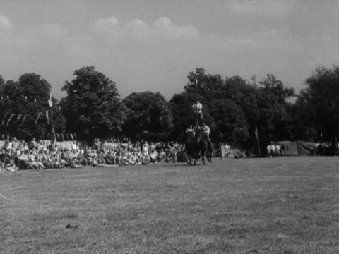 stockvideo's en b-roll-footage met horse riding cossacks performing tricks at the festival of youth celebrations at hampton court. - alle vlaggen van europa
