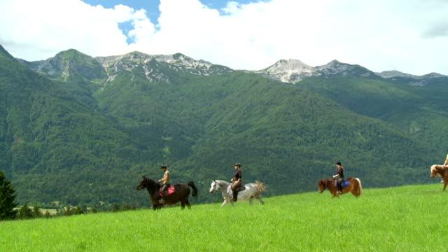 hd crane: horseback riding in julian alps - recreational horse riding stock videos & royalty-free footage