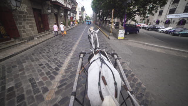 POV Horse-drawn carriage at Intramuros Spanish colonial city of Manila, Philippines. Stabilized shot personal perspective