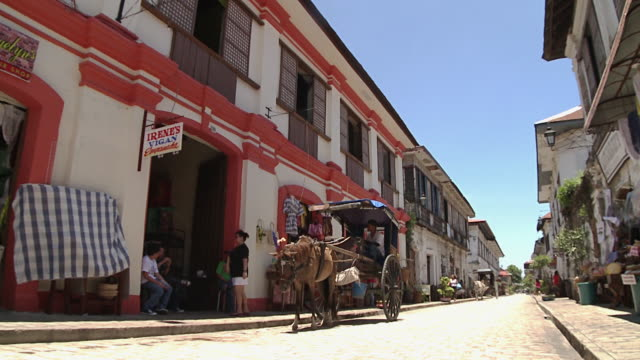 horse-drawn carriage on the street, vigan, philippines - horsedrawn stock videos & royalty-free footage