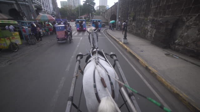 Horse-drawn carriage point of view at Intramuros Spanish colonial city of Manila, Philippines. Stabilized shot personal perspective
