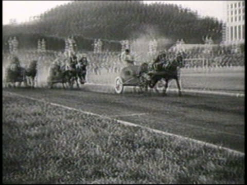 b/w 1951 horse-drawn chariots passing camera on track during race / italy / newsreel - 1951 stock videos & royalty-free footage