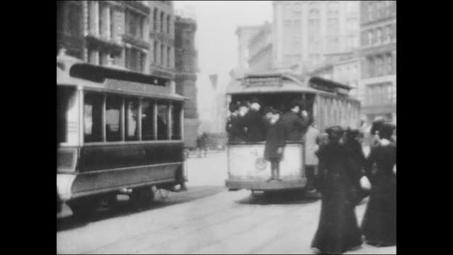 horsedrawn street car with a sign for broadway passengers on board / pedestrians walk pass on both sides of the street - broadway manhattan stock videos and b-roll footage