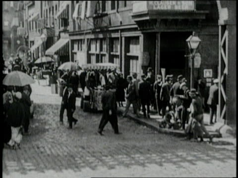 a horsedrawn trolley passes pedestrians and street vendors on a chicago street - 1900 stock videos & royalty-free footage