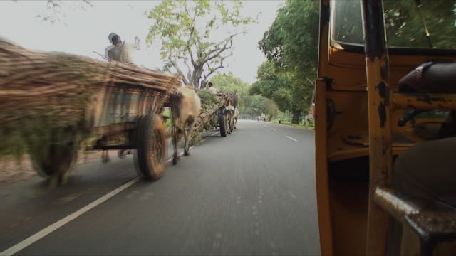 ws pov horsedrawn wagons on country road from side of tuk tuk in motion, pondicherry, india - rickshaw stock videos and b-roll footage
