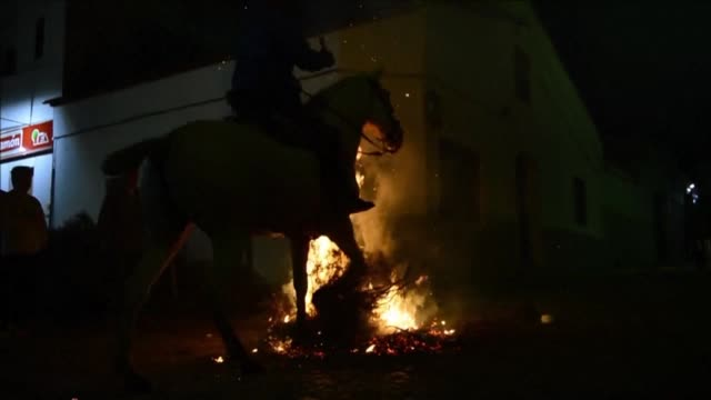 a horseman rides through a bonfire in central spain opening the traditional religious festival of las luminarias which honours the patron saint of... - religious saint stock videos and b-roll footage