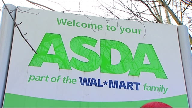 horse drug 'bute' found in asda corned beef england ext 'asda' sign at supermarket entrance anonymous shot of shopper along carrying asda carrier bags - 馬肉点の映像素材/bロール