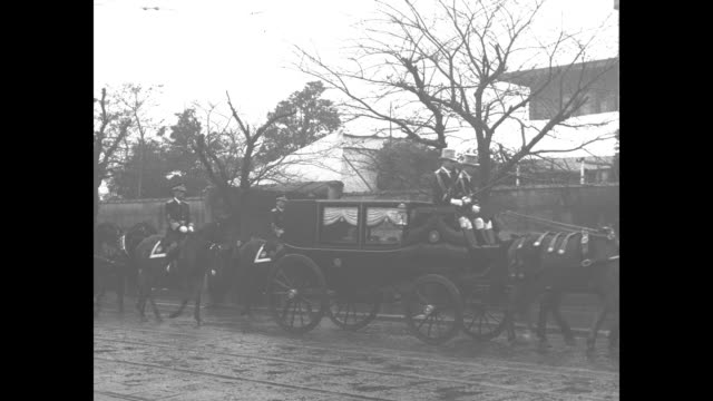 VS horses and horsedrawn carriages lead funeral procession of Yasuhito Prince Chichibu who is Japanese Emperor Hirohito's brother officer salutes as...