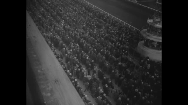 ls horses covered with blankets walk at stable / cu seabiscuit at rail with jockey red pollard and two other men / ms pollard rides seabiscuit around... - horse blanket stock videos & royalty-free footage