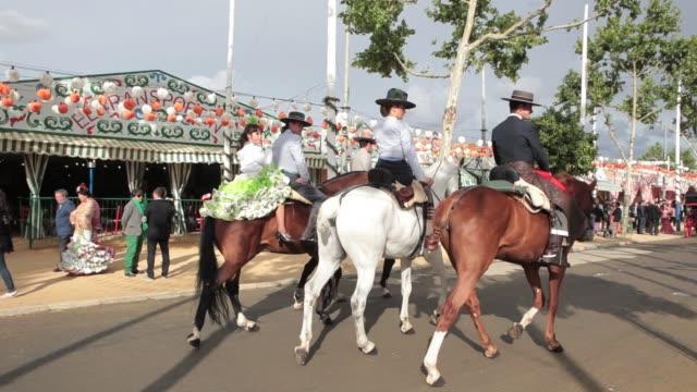 vídeos y material grabado en eventos de stock de horses cruising at the april fair in seville horses at april fair on april 29, 2012 in seville, spain - pasear en coche sin destino