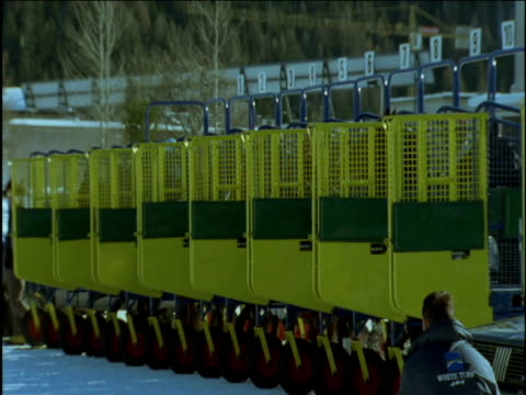 horses leave starting gates on snow track saint moritz - starting gate stock videos and b-roll footage
