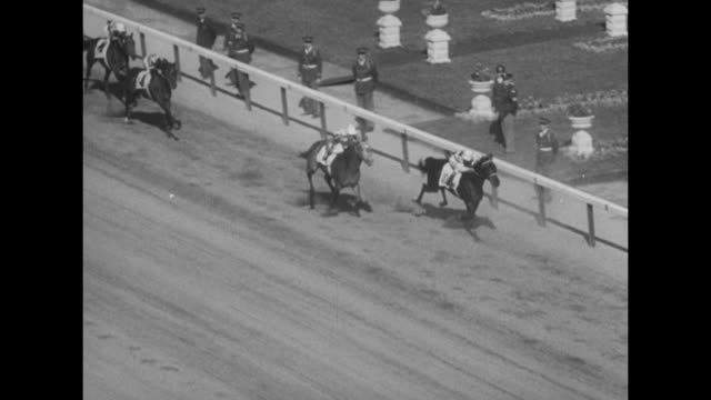 gv horses parade onto churchill downs racetrack with crowds and building on infield / cameraman films with warner pathe news labeled movie camera /... - star jump stock videos & royalty-free footage