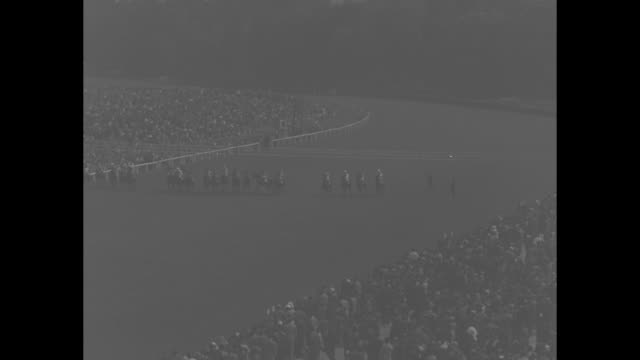 ws horses parade to post as crowds look on at longchamp racecourse / ws crowd in stands awaits running of the grand prix de paris race / french first... - cravat stock videos and b-roll footage