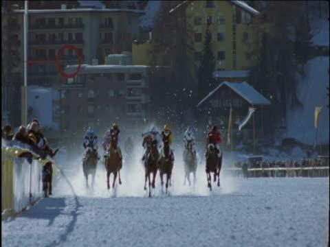 Horses race on snow track St Moritz