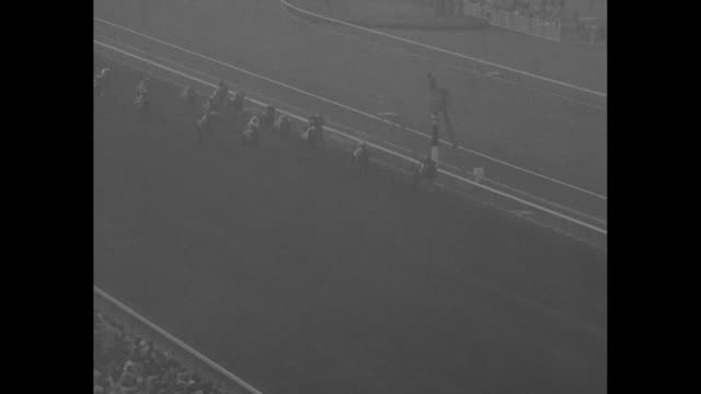 horses race on track at santa anita park with imbros in the lead in the santa anita handicap / men in suits look through binoculars on platform / men... - bugle stock videos and b-roll footage