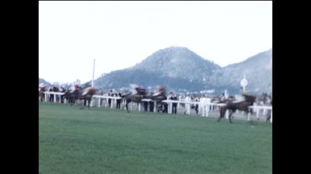 vídeos de stock, filmes e b-roll de horses run by at a race in rio de janiero. - 1940