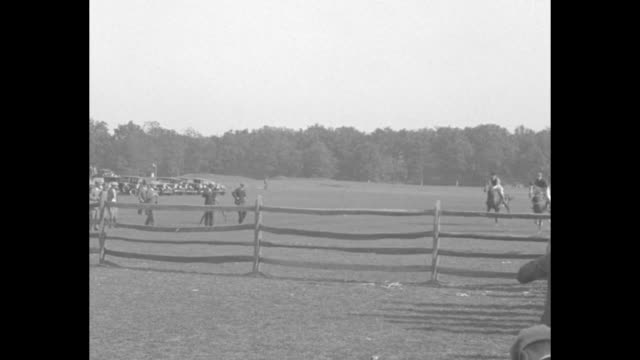 vs horses run manicured steeplechase course and winner eleanor wheeler takes trophy - steeplechase stock videos and b-roll footage