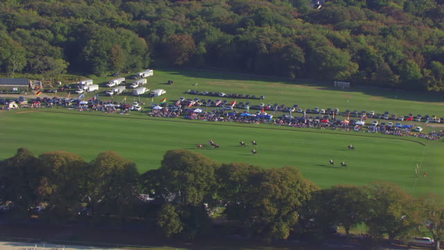 WS AERIAL POV Horses running on racecourse at Newport International Polo Series / Newport, Rhode Island, United States
