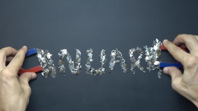 Hufeisen-Magnet In Menschenhand Textschreiben 1. Januar mit Metall Uhrwerk auf Tafel