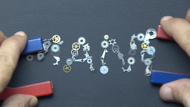 horseshoe magnet in human hand writing word nano with metal clockworks on blackboard - clockworks stock videos & royalty-free footage