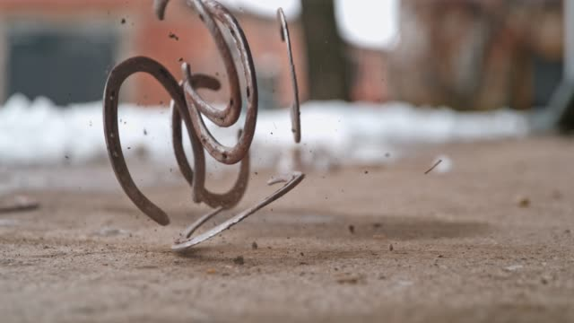 horseshoes falling on ground, super slow motion - horseshoe stock videos and b-roll footage