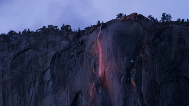 horsetail fall at sunset in yosemite national park - el capitan yosemite national park stock videos and b-roll footage