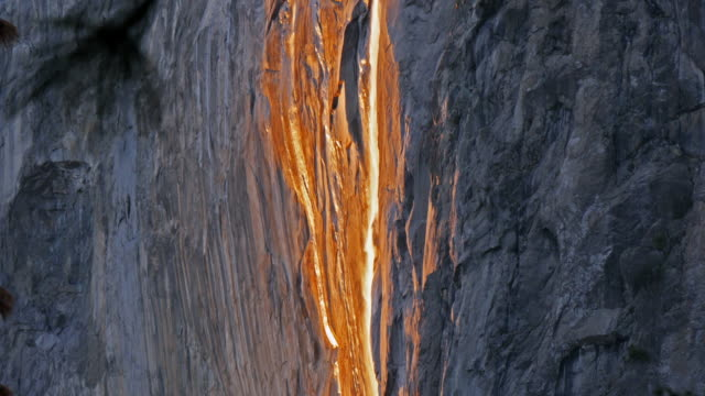 horsetail falls illuminated by sunset, yosemite, california, united states - yosemite nationalpark stock-videos und b-roll-filmmaterial
