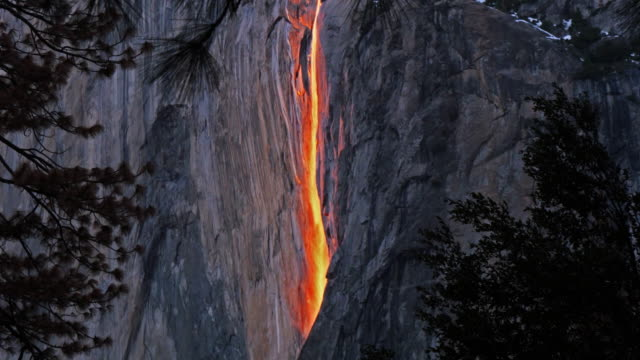 horsetail falls illuminated by sunset, yosemite, california, united states - yosemite national park stock videos & royalty-free footage
