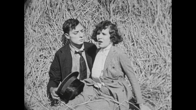 1922 Horsewoman (Virginia Fox) pays off man (Buster Keaton) who saved her from runaway horse