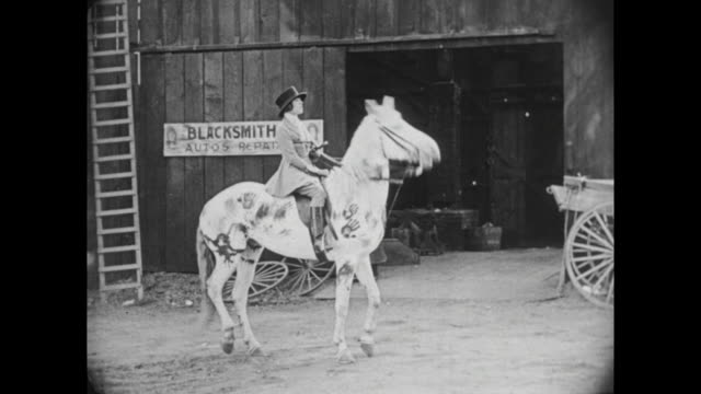1922 Horsewoman (Virginia Fox) rejects blacksmith (Buster Keaton)