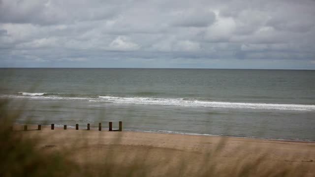 horsey beach norfolk england uk overcast sky - horsey england stock videos & royalty-free footage