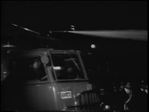 B/W 1967 hose spraying from fire truck on antiwar demonstration at night / Rome Italy / newsreel