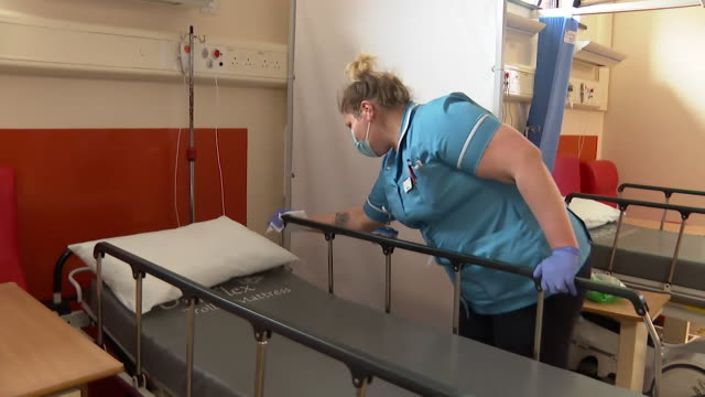 """hospital bed cleaned and disinfected in a and e department at ipsich hospital during coronavirus crisis - """"bbc news"""" stock videos & royalty-free footage"""