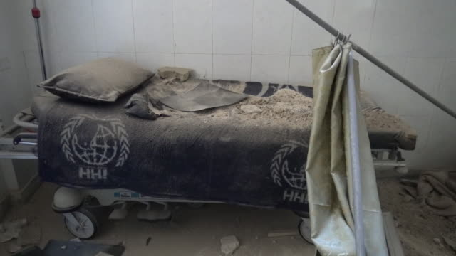 hospital beds covered in rubble after air strikes in aleppo syria - equipment stock videos & royalty-free footage