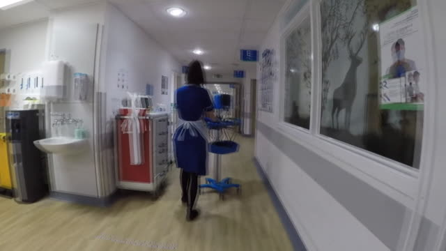 hospital corridor at addenbrooke's hospital in cambridge, not dealing with coronavirus patients - corridor stock videos & royalty-free footage
