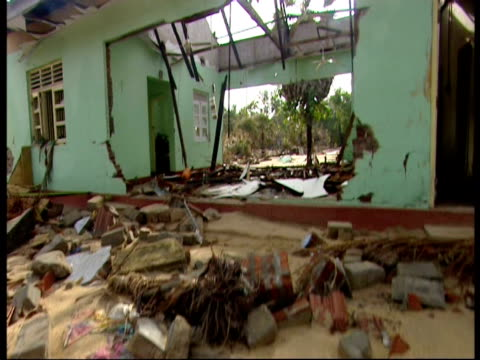 a hospital destroyed by the indian ocean tsunami where a clock stopped at the moment the water hit - 2004 stock-videos und b-roll-filmmaterial