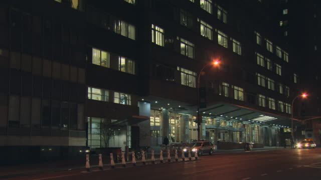 ms night hospital entrance, some cars pass / new york, new york, usa - medical building stock videos & royalty-free footage
