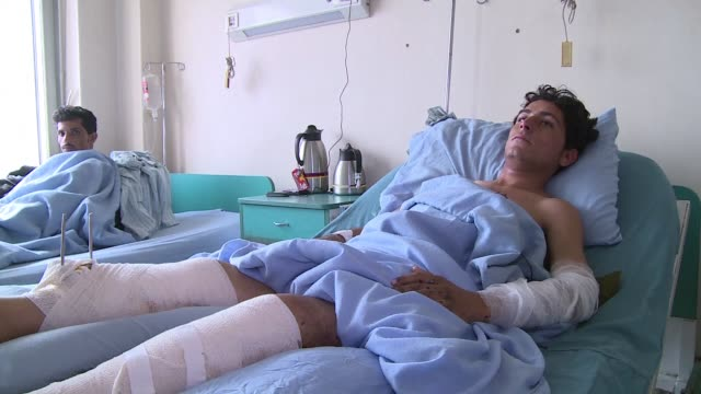 a hospital in kabul treats soldiers and taliban fighters alike provoking anger amongst afghan national army troops who have spent years battling the... - afghan national army stock videos and b-roll footage