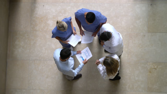 hospital manager, nurses and doctors in a meeting at the hospital - high angle view - manager video stock e b–roll