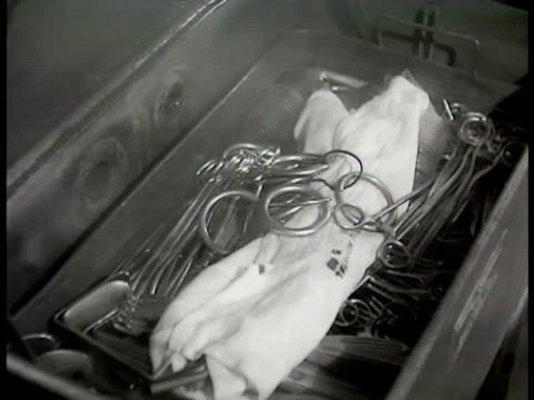 sterilization hospital operating room nurse or tecnician sterlizing surgical instruments tray opening steam rising nuses in mask gloves moving linen... - 1948 stock videos & royalty-free footage