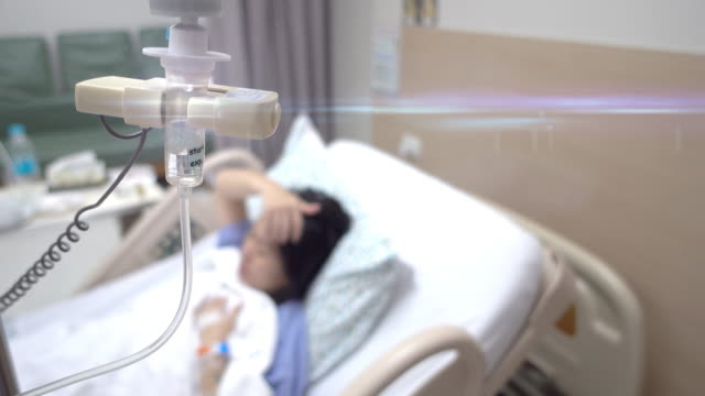 hospital, patient with iv drip - saline drip stock videos and b-roll footage