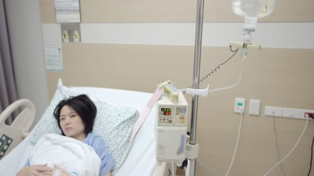 hospital patient with iv drip - saline drip stock videos and b-roll footage