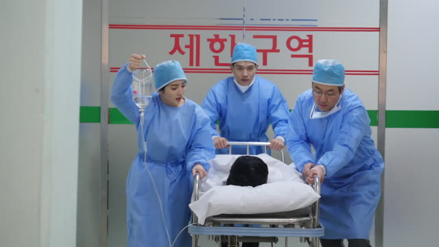 Hospital staff transporting a patient to the operating room