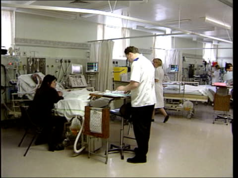 """hospital """"superbug"""" mrsa - rise in death rates; lib england: int hospital ward petri dish picked up cleaner sweeping in hospital corridor - staphylococcus aureus stock videos & royalty-free footage"""
