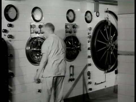 sterilization hospital technician in sterilizing room turning valves checking gauge on wall opening vaultlike door to autoclave talking out linen... - 1948 stock videos and b-roll footage